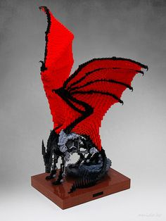 """A stuffed dragon.  """"It's a stuffed. Yes, a dragon. Since the guts have been removed, it won't rot any more. I stuffed it with lots of cogwheels and pipes and it could barely move its legs. The crimson wings exceptionally looks creepy against the cold machinery."""""""