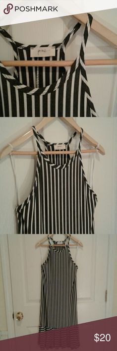 NWOT dress! Brand new, never worn, Pinc sleeveless razor back Gray and white striped dress with frill detailing on bottom. Pull over. !!!!Says large, but fits like a true medium!!!! Pinc Premium Dresses Midi