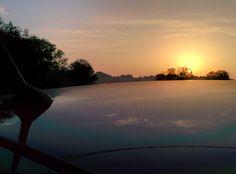 Dawn ferflection on car's rooftop