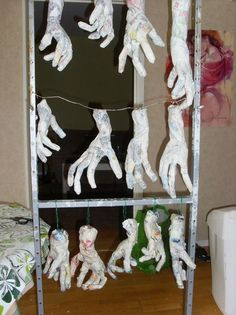 previous pinner said:I made little wire hand forms-covered the wires with crumpled paper and tape to make them look like real hands, and then I started paper macheing them. I've done about 15 pairs of hands so far.My idea is that I'm going to paint them black and have them hanging down at different lengths & sticking out from the wall.