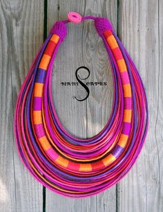 Gorgeous tribal yarn STATEMENT NECKLACE in different shades of pink, red, orange & violet. Vibrant colors and stunning look! Made with high qualitysilky smooth yarns (microfiber with silk effect, cotton, silk), non-allergic & cool to touch.  Reminiscent of African neckwear but made with a Slavic