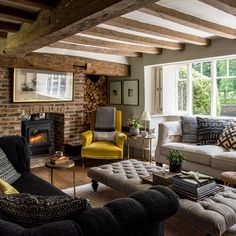 Country living room with exposed brick fireplace