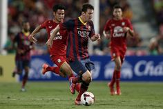 Lionel Messi #10 of Barcelona makes a break against Thailand XI during the international friendly match between Thailand XI and FC Barcelona at Rajamangala Stadium on August 7, 2013 in Bangkok, Thailand.