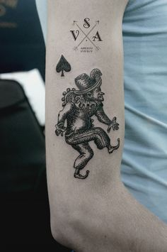 Playing card imagery?  Is it a Joker, a Knave (Jack) or an unconnected character teamed with the Ace of Spades symbol? Andrey Svetov.