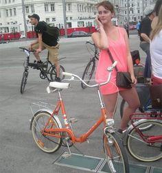 vintage orange folding bike