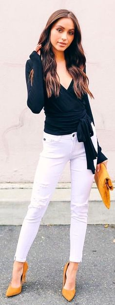 #winter #outfits  black surplice neckline wrap top with distressed white denim fitted jeans. Pic by @vicidolls.