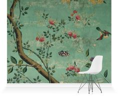 Printed wallpaper with flowering shrubs and fruit bees on a pale green background.