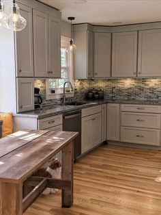 With a little bit of white and a little bit of gray, this inviting Oyster kitchen provides a view with style. Gray Cabinets, Kitchen Cabinets, Discount Cabinets, Kitchen Ideas, Kitchen Design, Grey Paint, Cabinet Doors, Oysters, House Design