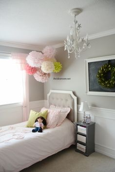 Follow this step by step tutorial to make some adorable Tissue Paper Pom Poms. Perfect for a girls room, nursery or your DIY wedding decor.