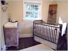 rustic nursery; like the angled crib with something in the corner. Maybe a barn door?!?!