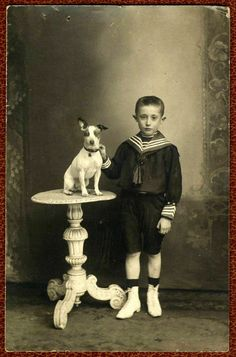 Edwardian boy in sailor suit and dog