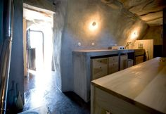 Interior photographs of the rental cottage in Tinos. The cave-like stone interior of this former stable on Tinos Island, Greece, is a small holiday house Stone Interior, Interior Design Kitchen, Hotel Interiors, Main Entrance, Stables, Traditional House, Cottage, Island, Deco