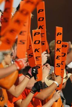 The OSU Paddle People raise their paddles during a college football game between Oklahoma State University (OSU) and West Virginia University (WVU) at Boone Pickens Stadium in Stillwater, Okla., Saturday, Nov. 10, 2012. Photo by Nate Billings, The Oklahoman