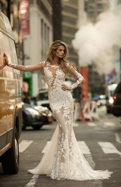 Brand new BERTA wedding dresses! A mermaid gown with long, sheer panels is paired with strategically-placed, opaque, form-fitting lace to create a sensual peek-a-boo effect on a BERTA wedding dress that is provocative, yet still elegant. See more new Berta Wedding Dresses here: http://www.confettidaydreams.com/berta-wedding-dresses/  via @confettidaydreams featuring @bertabridal