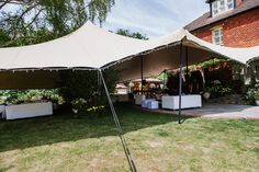 Stretch Tents quite literally stretch over any space, creating unique party areas out of patios or gardens.