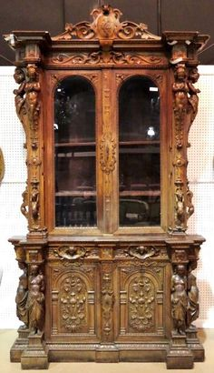 19th c. CONTINENTAL FIGURAL CARVED WALNUT CABINET : Lot 311