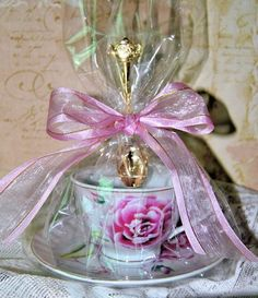 4 Pink Morning Teacup Favors includes beautiful porcelain tea cups and saucers with pink and white floral pattern on both. Each cello wrapped favor adorned with a lovely bow and demi spoon has yummy t