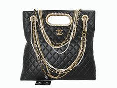 Chanel bag with chains - loving all the hardware.