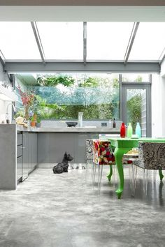 #loft #accent #table #cementfloors  Kitchen with green table and cement floor and great sky light. Can watch the stars!