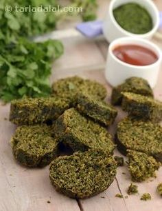 This famous Maharashtrian snack, with the dominant flavour of coriander, is sure to steal your hearts with its irresistible aroma, tongue-tickling taste and lovely crunch. What sets the Kothimbir Vadi apart from many other deep-fried snacks prepared all over the country is that the besan dough for preparing this is first steamed before being sliced and deep-fried. This gives it a wonderful texture, which is soft inside and crisp outside, as well as an intense flavour without any rawness.