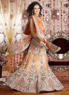 Peach bridal Lehenga.   Wedding Lehenga or reception Lehenga #amouraffairs www.amouraffairs.in