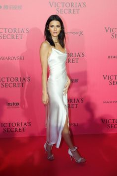 Model Kendall Jenner chose a slinky white Camilla and Marc dress for the 2016 Victoria's Secret Fashion Show After Party pink carpet.