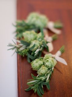 Hops and Rosemary Boutonniere-- theres even a huge hops bush growing on the side of the cabin, never even thought of using those in the flowers