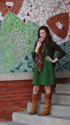 pretty green dress from Anthropologie -- I like the way she styled it with the boots & scarf!