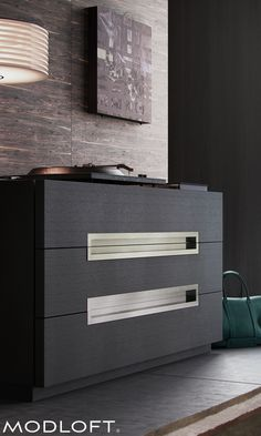 The very chic Modloft Monroe dresser with impressive extruded aluminum handles doubles as a bedroom TV stand (ideal height). Available in our quick-ship program for immediate delivery.