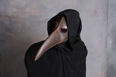 This Plague doctor mask is ready to ship in 1-3 business days.   Delivery periods 1 to 4 weeks and its dependant of where you live   I made this plague doctor mask using top quality italian leather. This steampunk plague doctor mask is entirely handmade, from cutting the leather to the sewing.  The lenses i use are original sunglasses lenses and i can also switch the lenses of all my leather masks.   Please feel free to message me if you have any other questions about my masks, i will be…