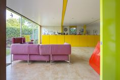 Bold, bright colours with curtain wall create a fun, exciting space. Energy of space controlled by relatively low ceiling height.
