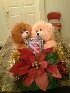 Poinsettia with 2 bears and pitcher frame with garland on a solid base. $29.00 shipping and handling not included
