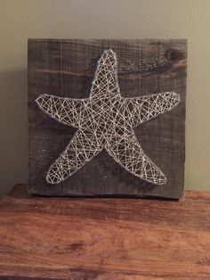 Hand strung string art on aged 1 inch thick boards.