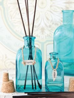 Christen Hammons dresses up her reed diffusers with plaques and necklaces for a decorative touch that adds a bit of charm. | Willow and Sage