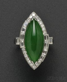 Platinum, Jadeite, and Diamond Ring, set with a cabochon marquise-shaped jadeite measuring approx. 19.00 x 8.00 x 4.10 mm, framed by baguette- and single-cut diamond melee. Undated but assumed to be Art Deco or Art Deco style