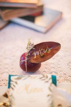 place cards written on leaves, photo by Tom and Keidi Photography http://ruffledblog.com/leafy-winter-inspiration #placecards #reception