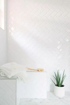 Master Bathroom From HGTV Dream Home 2016 - An inexpensive alternative to more pricey tiles, simple subway tiles were installed in a herringbone pattern in the shower. White grout between the tiles lends a more cohesive look. White Subway Tile Bathroom, Subway Tile Showers, Modern White Bathroom, Beautiful Bathrooms, Small Bathroom, Shower Tiles, White Master Bathroom, White Bathrooms, Beveled Subway Tile