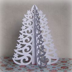 Paper Hanging Christmas Trees - It seems like the original source of this craft does not exist anymore. Description from pinterest.com. I searched for this on bing.com/images