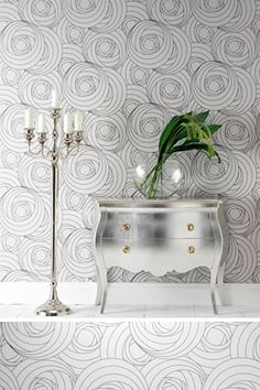 If gray is the new neutral, then silver leaf furniture is the new giltwood. Like gold leafing, you can silver leaf furniture and décor as a DIY project. This chest of drawers looks fantastic against the graphic modern wallpaper. Silver Decor, Mirrored Furniture, Silver Furniture, Contemporary Wallpaper Designs, Contemporary Wallpaper, Home Decor, Modern Wallpaper, Trending Decor, Glam Furniture