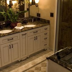 This gorgeous bathroom uses Emperador Dark Marble Countertop & Shower Surround. But check out the great floor pattern!