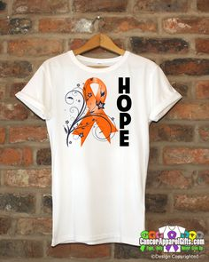 Hope inspires with our line of Cervical Cancer HOPE Floral Ribbon shirt featuring an eye-catching floral design with HOPE displayed boldly on the shirt and awareness ribbon for the cause. Wear it duri Cancer Awareness Shirts, Childhood Cancer Awareness, Awareness Ribbons, Leukemia Awareness, Endometrial Cancer, Breast Cancer Shirts, Ribbon Shirt, Cervical Cancer