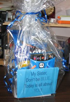 "This is a take on the ""Orange"" gift that I saw on Pinterest a few months ago. I made this for my Secret Sister. ""Don't be BLUE, today's all about YOU!"" In it I included a box of Mike & Ikes, Doritos Ranch, a bar of Dove chocolate, peanuts, a can of Pepsi and a box of berry blue Jello. She loved it ... by the way, I also made the ""orange"" gift for her."