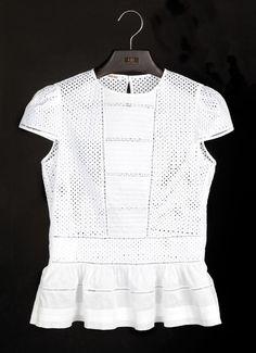 Fotogalería: Las blusas blancas de Carolina Herrera                                                                                                                                                                                 Más