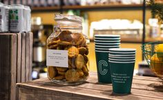 Branded coffee cups and price tags designed by 25ah for Stockholm cafe Caldo Coffee at the Scandic Continental