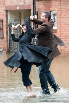 A couple dancing in the streets during the Avon flood in Stratford, England. (2007).