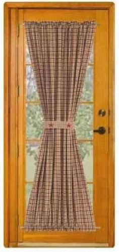 French doors have become quite popular nowadays as they let in the light and make a room look larger by providing a home with a more open feel. The only downside people cite to French doors is that they do not provide privacy. However, adding curtains is French Country Living Room, French Country Style, Prim Decor, Country Decor, Porta Colonial, French Door Curtain Panels, French Door Window Coverings, Curtain Rods, Black French Doors