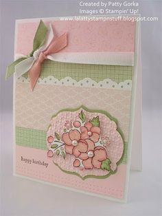 delightful card in pink with white and green accents...lovely flower image with pearl centers...