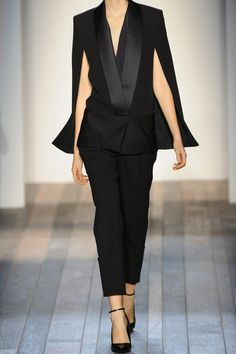 Black on Black on Black VICTORIA BECKHAM Silk and wool-blend cape jacket.