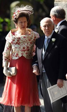 The mother-of-the-bride, Princess Anne, looked beautiful in a peach dress, cream and pink embroided jacket and an elaborate lace and flower detail fascinator. <br>Photo: WireImage