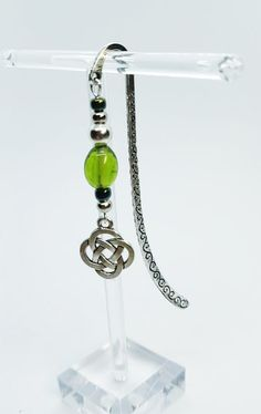 The first of my Limited Edition Celtic collection, this beautiful bookmark which Ive designed with silver and green glass beads and finished with a Celtic knot charm. Celtic knots are complete loops that have no start or finish, they are thought to represent eternity, whether this be through